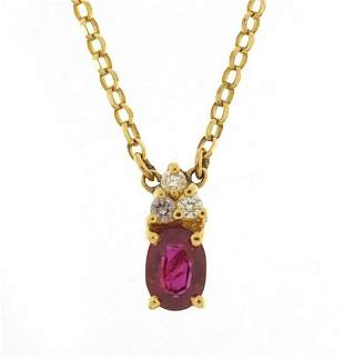 18ct gold ruby and diamond pendant on an...