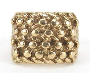 Unmarked gold four row keeper ring, (tes...
