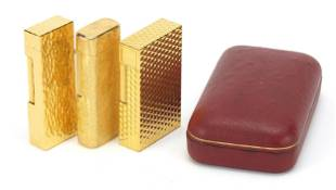 Three vintage gold plated pocket lighter...