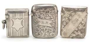 Three Victorian silver vestas with engin...