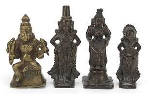 Four Indian patinated bronze votive figu...