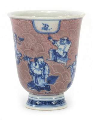 Chinese blue and white with iron red por...