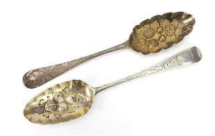 Two Georgian silver berry spoons includi...