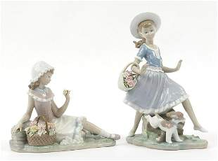 Two Lladro figurines of girls with flowe...