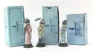 Three Lladro Geisha girls with boxes num...
