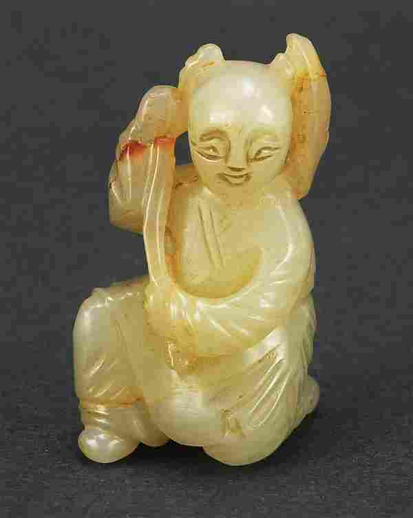 Chinese celadon jade carving of a young ...