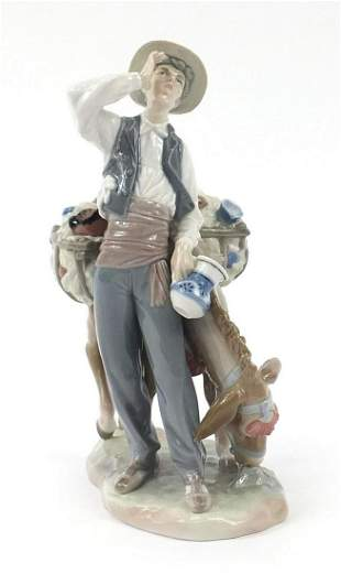 Lladro figure of a man with donkey, Typi...