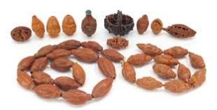 Chinese carved coquilla nuts and a walnu...