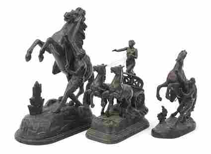 Three patinated bronze Marley horse with...
