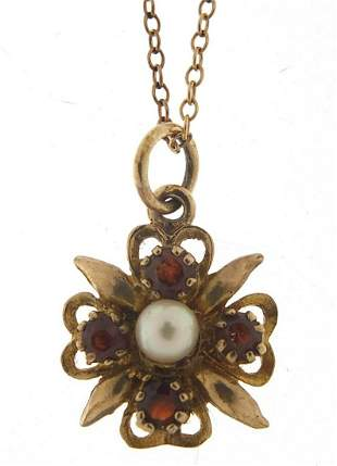 9ct gold garnet and pearl pendant on a 9...