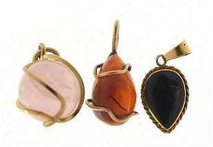 Three semi precious stone pendants inclu...