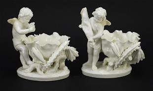 Moore, pair of Victorian porcelain Putti...