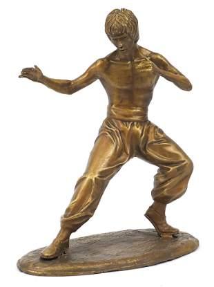 Gilt painted bronze figure of Bruce Lee,...