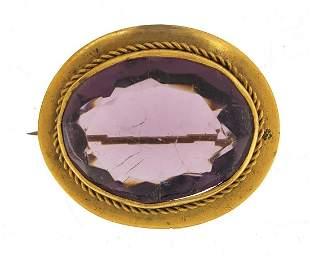 Victorian gilt metal amethyst brooch, 3....
