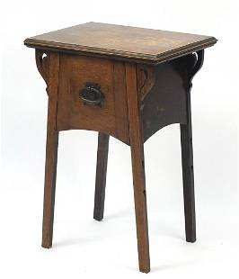 Arts & Crafts carved oak side table with...