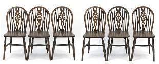 Set of six oak wheel back dining chairs,...