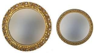 Two circular gilt framed convex wall mir...