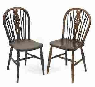 Two oak wheel back dining chairs, each 9...