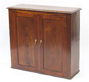 Oak and mahogany two door cupboard enclo...