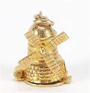 9ct gold windmill charm opening to revea...