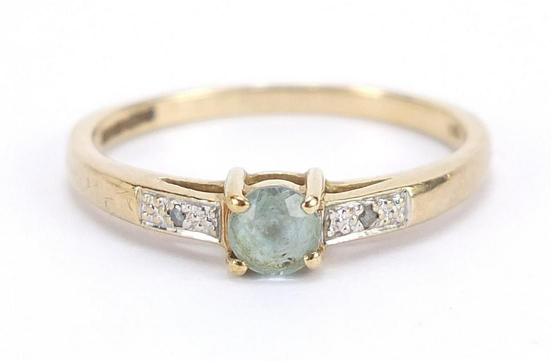 9ct gold blue stone ring with diamond sh...