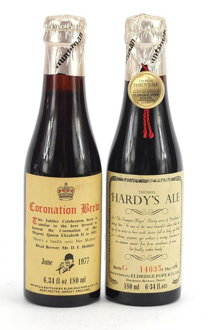 Two commemorative bottles of alcohol com...