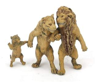Cold painted bronze lion family in the s...