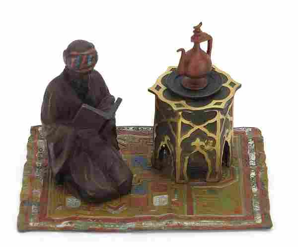 Cold painted bronze figure of an Arab on...