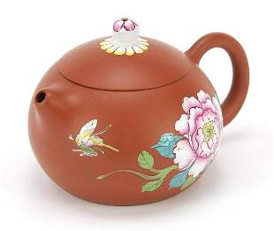 Chinese terracotta teapot enamelled with...