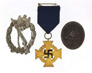 Three German military interest badges in...