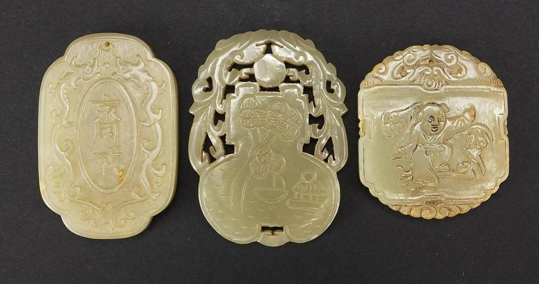 Three Chinese celadon jade pendants carv...