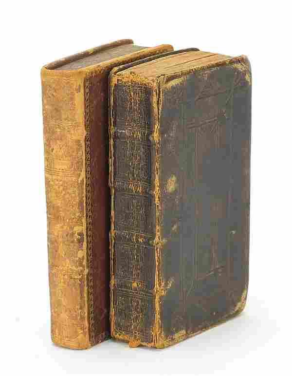 Two antique leather bound hardback books...