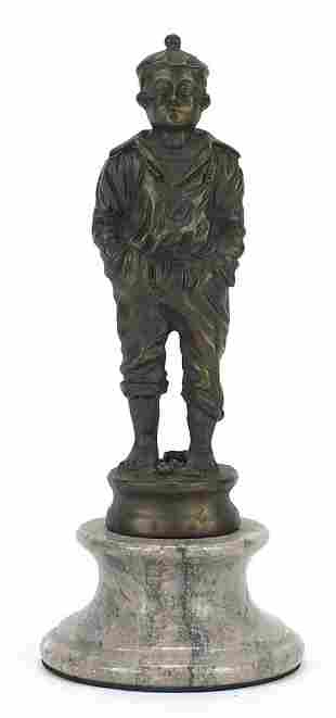 Patinated bronzed figure of a young sail...