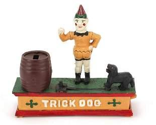 Painted cast iron trick dog money box, 2...