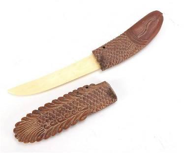 Scrimshaw style carved wood fish design ...
