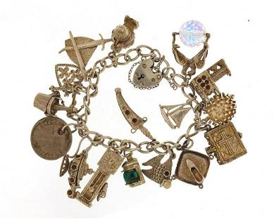 Silver charm bracelet with selection of ...