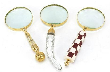Three magnifying glasses including one w...