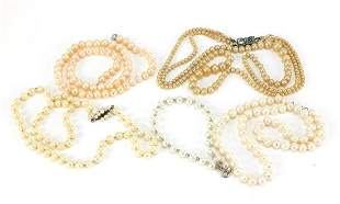 Four pearl and simulated pearl necklaces...