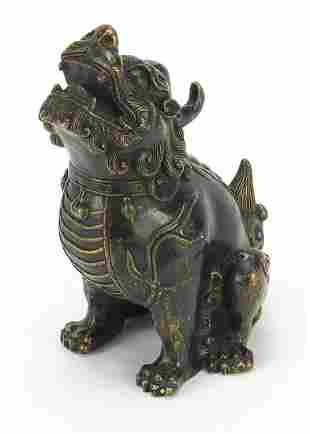 Chinese patinated bronze Foo dog, four f...