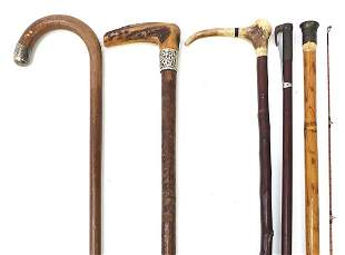 Four walking sticks and a Hardy fishing ...