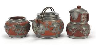 Chinese pewter mounted terracotta teapot...