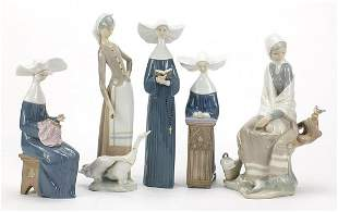 Five Lladro figurines including set of t...