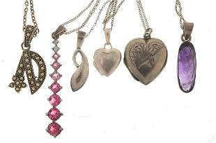 Six silver pendants on silver necklaces ...