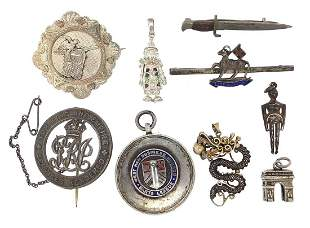 Brooches, badges and charms, some silver...