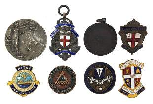 Badges and medallions including an Elkin...