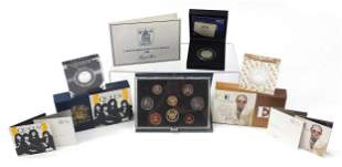 Three UK silver proof coins and a 1986 p...