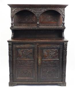 Antique oak court cupboard carved with figures feeding