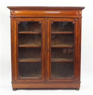 Mahogany bookcase fitted with a pair of glazed doors