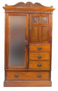 Edwardian carved walnut wardrobe with mirrored door,