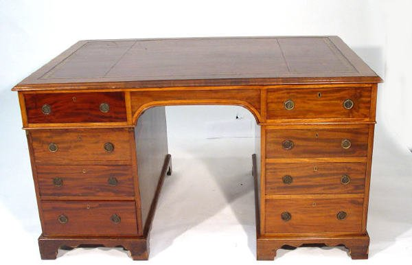 7: Victorian mahogany Partners desk, the top with red t
